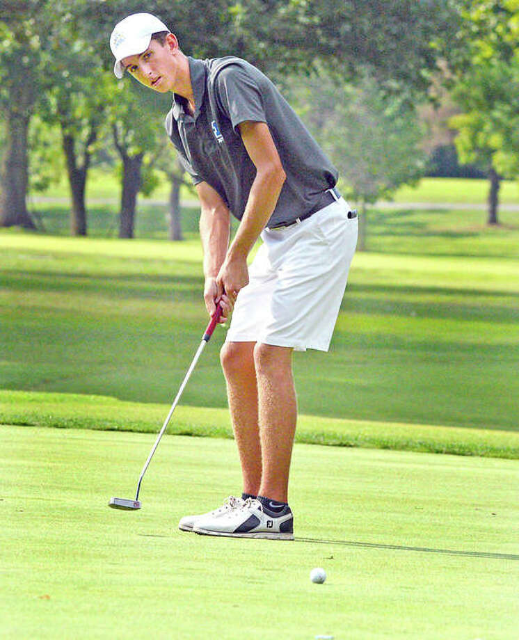 Marquette's Kolten Bauer putts on hole No. 13 at Belk Park Golf Course during Thursday's Madison County Tournament. Photo:       Scott Marion | For The Telegraph