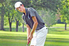 Marquette's Kolten Bauer putts on hole No. 13 at Belk Park Golf Course during Thursday's Madison County Tournament.