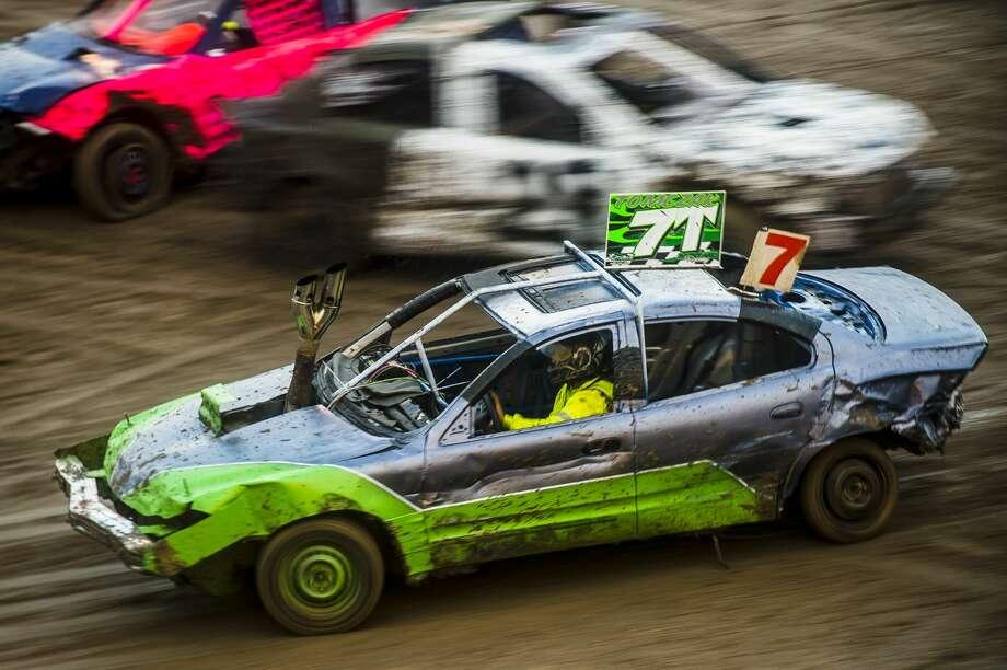 Drivers race during a figure 8/burnout rally on Thursday, Aug. 16, 2018 at the Midland County Fairgrounds. (Katy Kildee/kkildee@mdn.net) Photo: (Katy Kildee/kkildee@mdn.net)