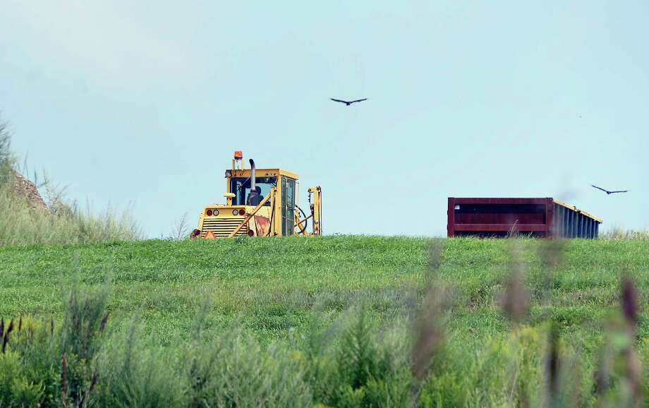 Heavy equipment at the Rapp Road Landfill Thursday August 16, 2018 in Colonie, NY. Albany officials now are projecting the Rapp Road Landfill won't close until 2026, giving the city more time to determine a long-term solution. Meanwhile, a pilot for a pay-as-you-throw system won't be launched next year, leaving things like the trash fee as status quo.  (John Carl D'Annibale/Times Union) Photo: John Carl D'Annibale / 20044582A