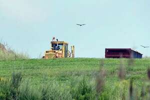 Heavy equipment at the Rapp Road Landfill Thursday August 16, 2018 in Colonie, NY. Albany officials now are projecting the Rapp Road Landfill won't close until 2026, giving the city more time to determine a long-term solution. Meanwhile, a pilot for a pay-as-you-throw system won't be launched next year, leaving things like the trash fee as status quo.  (John Carl D'Annibale/Times Union)