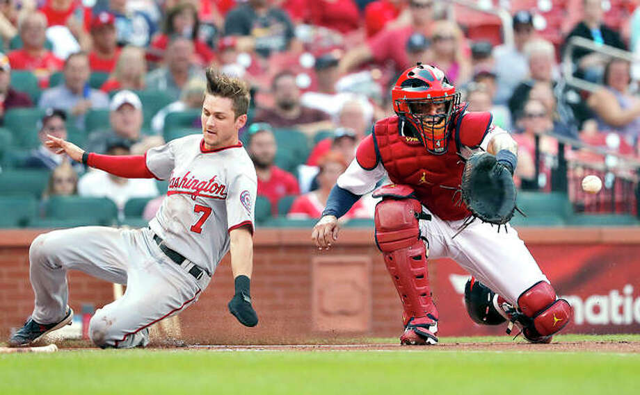 Washington's Trea Turner (7) scores past Cardinals catcher Yadier Molina in the first inning of Thursday night's game Thursday in St. Louis. Photo:       Jeff Roberson | AP Photo