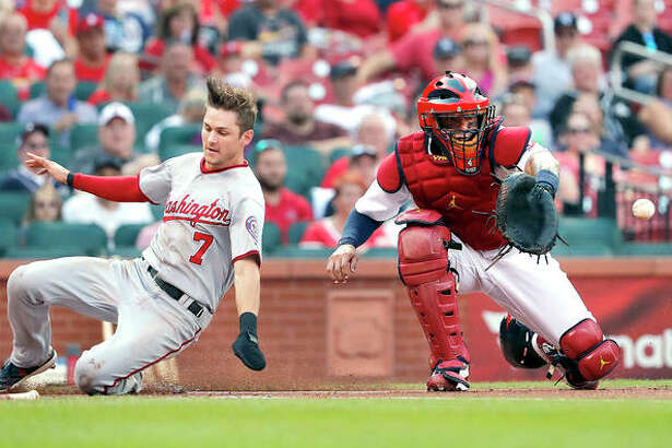 Washington's Trea Turner (7) scores past Cardinals catcher Yadier Molina in the first inning of Thursday night's game Thursday in St. Louis.