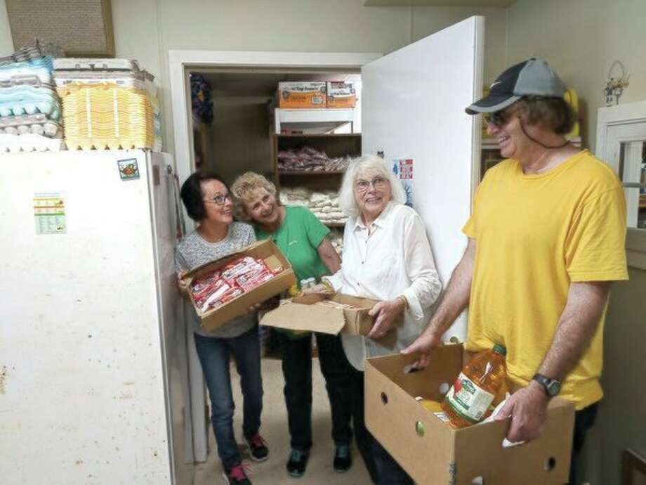 Hauling in nearly 200 pounds of food to the Beaverton Helping Hands Mission are director Becky Cook, mission volunteer Bev Whitmer, Nancy Wallace and William Wallace Jr. (Tereasa Nims/For the Daily News)