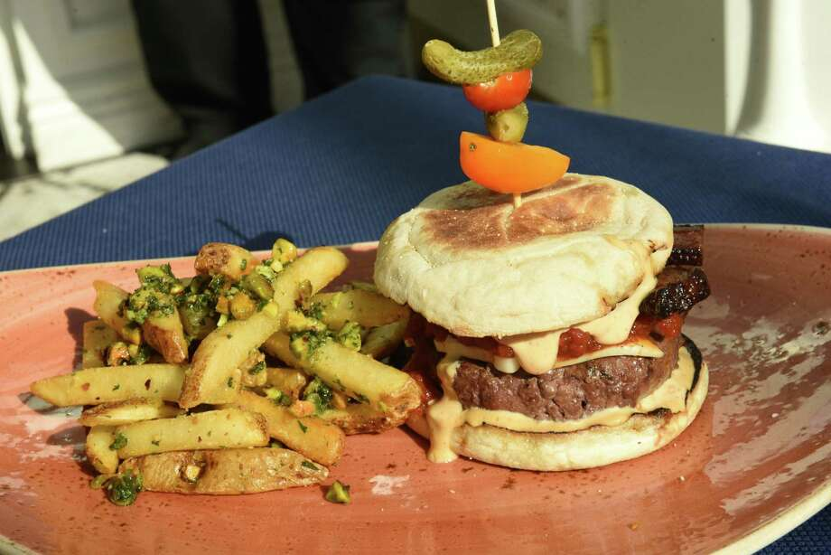 Dry aged burke burger english muffin, B1 mayo, smoked tomato jam, pistachio gremolata frites at Morrissey's at the Adelphi on Thursday, Aug. 9, 2018 in Saratoga Springs, N.Y. (Lori Van Buren/Times Union) Photo: Lori Van Buren / 20044524A