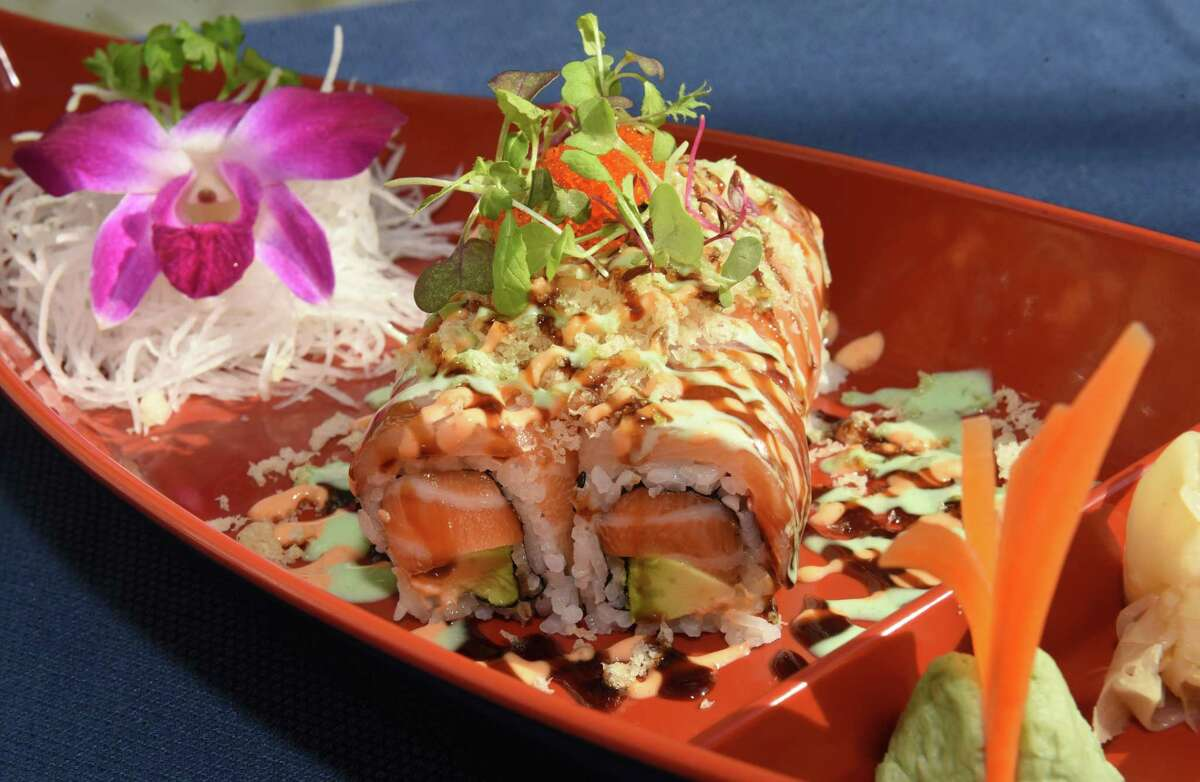 French cake, spicy salmon, avocado, topped with tobiko, yellowtail, salmon, tempura flakes, teriyaki sauce, spicy sauce and house special sauce at Morrissey's at the Adelphi on Thursday, Aug. 9, 2018 in Saratoga Springs, N.Y. (Lori Van Buren/Times Union)