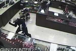 Federal authorities are offering up to a $10,000 reward for information on two men who stole 16 handguns and jewelry from a pawn shop in north Laredo on Wednesday.