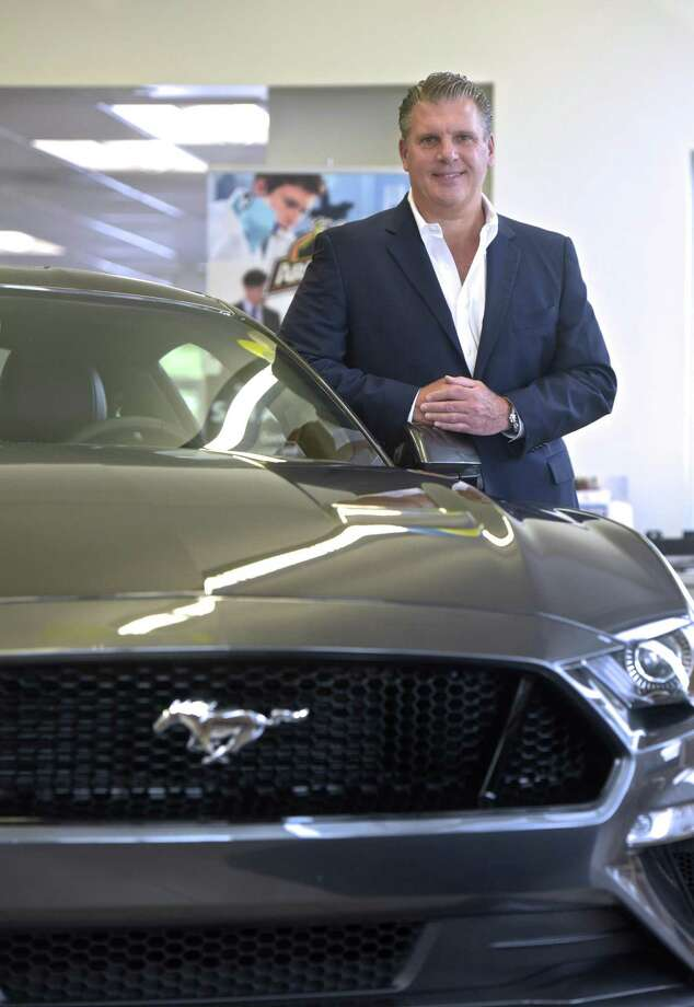 David Beylouni, president and co-owner of Colonial Automobile Group, stands next to a 2018 Ford Mustang GT in the Colonial Ford Showroom. Thursday, August 16, 2018, Danbury, Conn. Photo: H John Voorhees III / Hearst Connecticut Media / The News-Times
