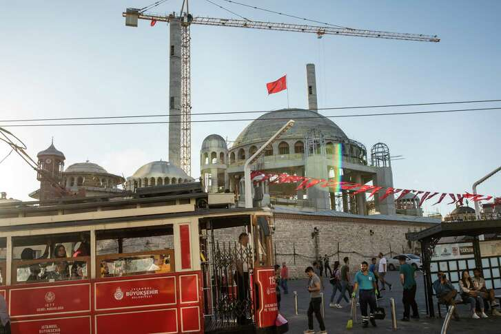 A mosque under construction on Taksim Square in Istanbul, Aug. 13, 2018. Turkey has unique challenges, but other emerging markets where big borrowing fueled rapid growth and strong returns could feel the pinch of a stronger dollar.
