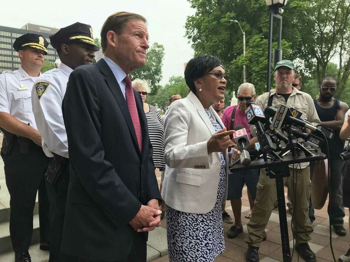 U.S. Sen. Richard Blumenthal, New Haven Mayor Toni N. Harp, and Police Chief Anthony Campbell address the media Friday about the mass of overdoses that have occurred on and around the city Green.