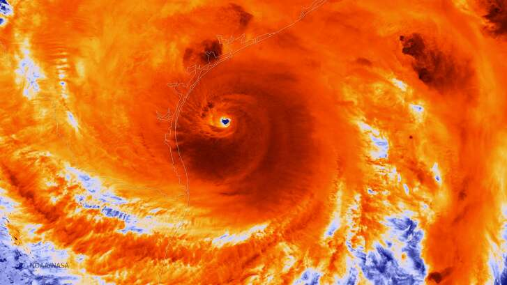 In this NOAA handout image, the NOAA/NASA Suomi NPP satellite captures this infrared image of Hurricane Harvey just prior to making landfall at 18:55 UTC on August 25, 2017 along the Texas coast. NOAA's National Hurricane Center has clocked Harvey's maximum sustained winds at 110 miles per hour with higher gusts. Infrared images like this one can help meteorologists identify the areas of the greatest intensity within large storm systems, such as the areas with the most intense convection, known as overshooting cloud tops (dark orange), surrounding the eye and along the outer bands.