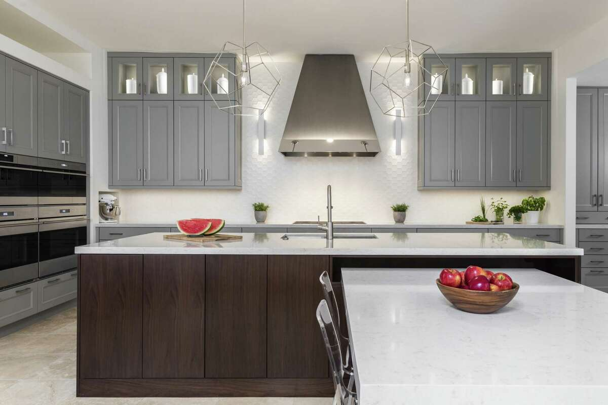 The kitchen got a complete makeover, from dated and funky to fully contemporary. They also turned it into an eating kitchen with a porcelain slab covered table that comes out of one side of the island.