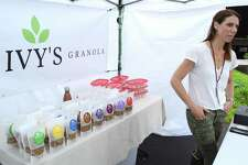 Sarah Tamm, owner of the Westport-based Ivy's Gourmet Granola, minds her store at the weekly New Canaan Farmers Market, Saturday, Aug. 11.
