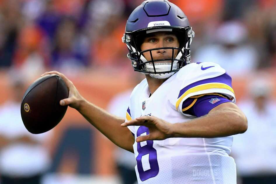Minnesota Vikings quarterback Kirk Cousins looks to throw a pass against the Denver Broncos during the first half in an NFL preseason football game Saturday, Aug. 11, 2018, in Denver. (AP Photo/Mark Reis)