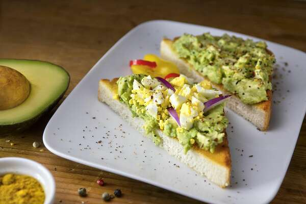Flyers can customize their own avocado toast at the American Airlines Admirals Club