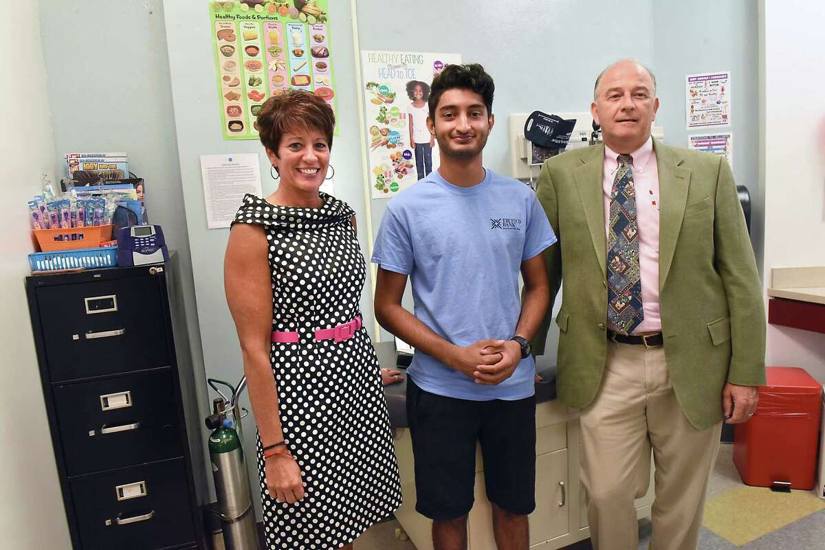 From left, Lori Caplan, superintendent, senior student Zagham Shah, and David Shippee, President and CEO Whitney M. Young, Jr. Health Center, stand in the health center at Watervliet Junior / Senior High School on Friday, Aug. 17, 2018 in Watervliet, N.Y. Whitney M. Young, Jr. Health Center and Watervliet City Schools opened the school-based health center for students in the district for the upcoming school year. The center is located in the nurses office of the school.(Lori Van Buren/Times Union)