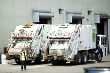 Garbage trucks sit waiting to be filled at the Stamford Transfer Station on Harborview Ave. in Stamford, Conn. on Thursday, Aug. 16, 2018. Many recyclables, which were once discarded at Katrina Mygatt Recycling Center, now are being brought to the transfer center to be sorted because the market for recyclables has collapsed and the city would have to pay an exorbitant fee for them to be hauled away.