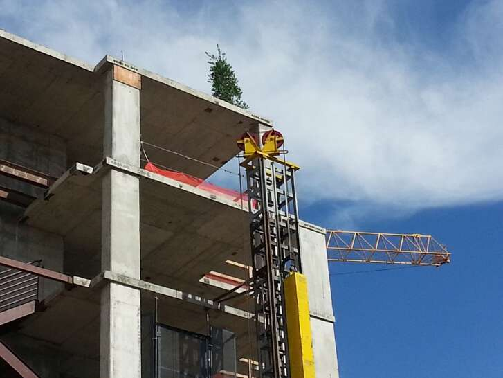 November 2013: The traditional topping out fir tree atop the frame of the future Belmont Village Hunters Creek senior living community in Houston.