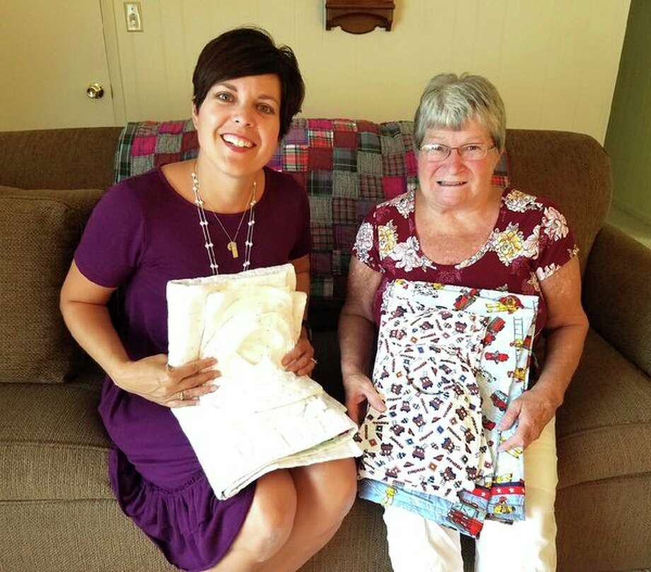 Pictured are Amy Dumaw of the Sanilac County Child Abuse Prevention Council and Ann Miller. (Submitted Photo)
