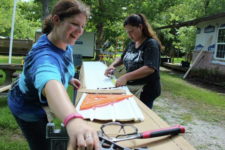 Angela Lovero, left, and Jenny Oliver work to rebuild a home Brookside Village that was damaged by Hurricane Harvey. Lovero is from New Jersey and is part of the Samaritans Purse effort, which is still assisting area residents with recovery from last August's flooding. helping her is Jenny Oliver, a Liverpool resident who recently moved back into her Harvey-damaged home after spending a year in an apartment.