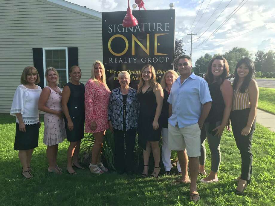 Agents at the Signature One Realty Group celebrated the grand opening of a new office at 2575 Route 9, Malta Wednesday. Left to right: Real estate salespeople Dharma Sanchez-Flores, Carolyn Samora, Jennifer Deuel, Broker/Owner Cindy Quade, salesperson Ro Quade, assistant Jenna Tuttolomondo, Associate Broker Patti Quade, salespeople Tony Gambaro, Jayne Schermerhorn and Genevieve Suguitan. (Photo: Leigh Hornbeck/TimesUnion)