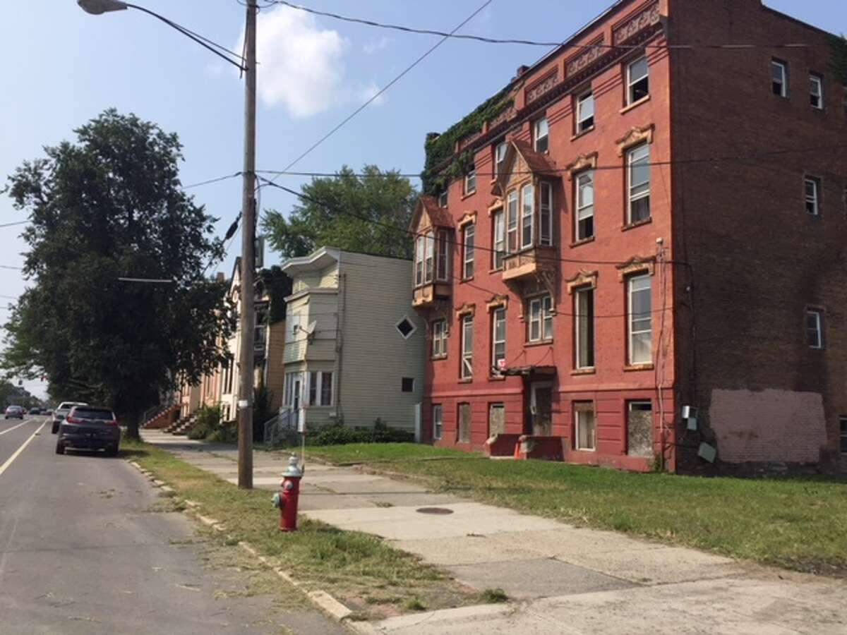 A swath of buildings and vacant lots along Clinton Avenue in Albany were purchased earlier this year by local developer Patrick Chiou through the Albany County Land Bank. The land bank marked its 300th property sale on Thursday, Aug. 16, 2018.
