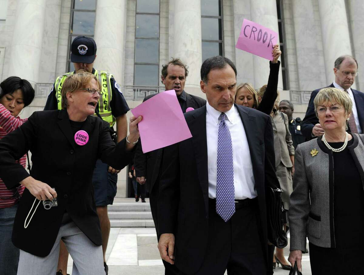 Former Lehman Brothers CEO and Greenwich resident Richard Fuld Jr. is heckled in October 2008 by protesters in Washington, D.C., after testifying before the House Oversight and Government Reform Committee on the collapse of Lehman Brothers. (AP Photo/Susan Walsh)