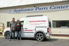 Appliance Parts Center ownersFernando and Shannon Hinojo stand in front of the business, which was opened by Shannon's father, Vinnie Pearl, in 1996. (Seth Stapleton/Huron Daily Tribune)
