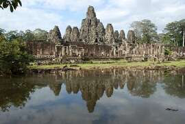 archiveplease Angkor Thom was built almost 1,000 years after Angkor Wat and is almost as impressive in Siem Reap, Cambodia. (Don Faust/Philadelphia Inquirer/MCT)