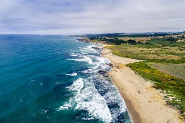 The 414-acre Bolsa Point Ranch in Pescadero, Calif., offers the opportunity for a true California lifestyle with verdant farmland rolling toward rugged cliffs overlooking secluded beaches and multiple historic farm buildings including a barn.