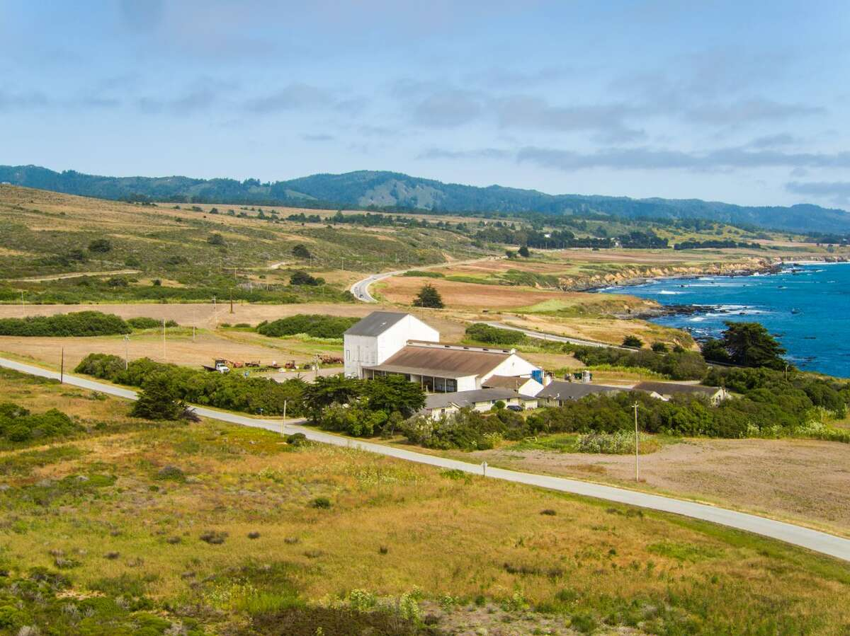 The 414-acre Bolsa Point Ranch in Pescadero, Calif., offers the opportunity for a true California lifestyle with verdant farmland rolling toward rugged cliffs overlooking secluded beaches and multiple historic farm buildings, including a barn.