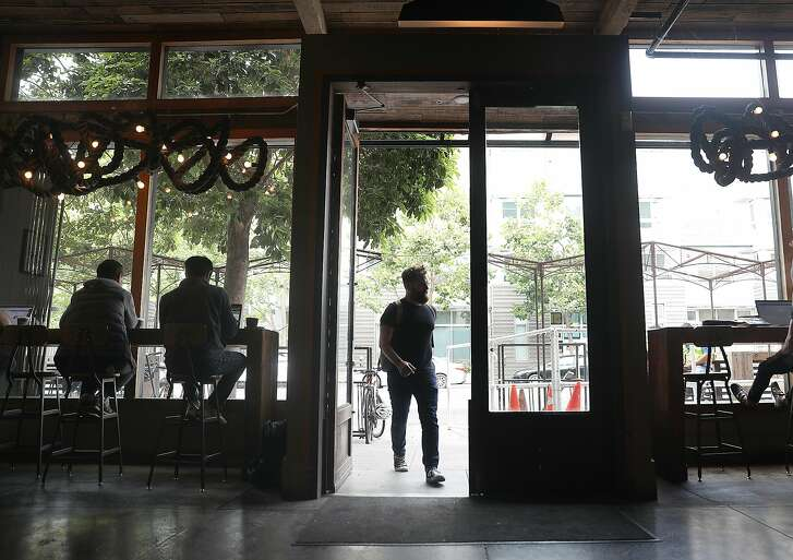View of the Four Barrel coffee shop from the inside looking through the front door on Wednesday, Aug. 15, 2018 in San Francisco, Calif.