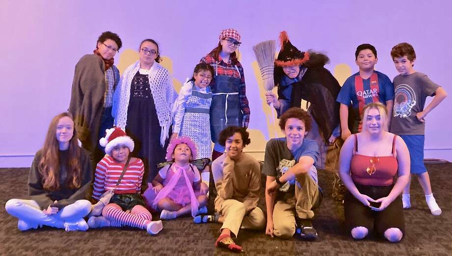 "CAFTA's students are presenting ""Hansel and Gretel"" Saturday afternoon in Torrington. Back row, from left, are Laciegh ""Tyler"" Richeme (Father); Tariana Medina (Mother); Madeline Vega (Gretel); Emma Wisniewski (Hansel); John Sullivan (the Wicked Witch); Nick Borja (Narrator); Dylan Theeb (Narrator). Front row: Heather Thompson (crew and Gingerbread Kid); Zalisha Borja (Sand Elf); Yereli Borja (Dew Fairy); Ella Hathaway ( crew and Gingerbread Kid); Jayden Burrelli (crew and Gingerbread Kid); Kaylee Stickney (stage manager). Photo: Contributed Photo / Teresa Graham Sullivan"