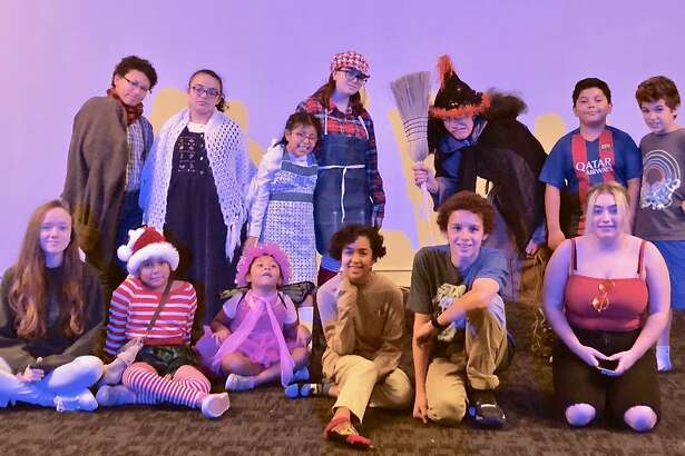 "CAFTA's students are presenting ""Hansel and Gretel"" Saturday afternoon in Torrington. Back row, from left, are Laciegh ?""Tyler?"" Richeme (Father); Tariana Medina (Mother); Madeline Vega (Gretel); Emma Wisniewski (Hansel); John Sullivan (the Wicked Witch); Nick Borja (Narrator); Dylan Theeb (Narrator). Front row: Heather Thompson (crew and Gingerbread Kid); Zalisha Borja (Sand Elf); Yereli Borja (Dew Fairy); Ella Hathaway ( crew and Gingerbread Kid); Jayden Burrelli (crew and Gingerbread Kid); Kaylee Stickney (stage manager)."