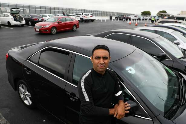 Uber driver Mustafa Ayubi poses for a portrait in the TNC parking lot #1 in Millbrae, California, on Tuesday, Aug. 14, 2018.