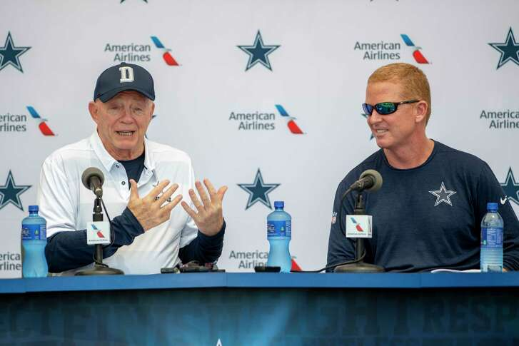 "Dallas Cowboys owner Jerry Jones, left and head coach Jason Garrett take questions from the press during the ""state of the team"" press conference at the start of Dallas Cowboys' NFL training camp, Wednesday, July 25, 2018, in Oxnard, Calif. (AP Photo/Gus Ruelas)"