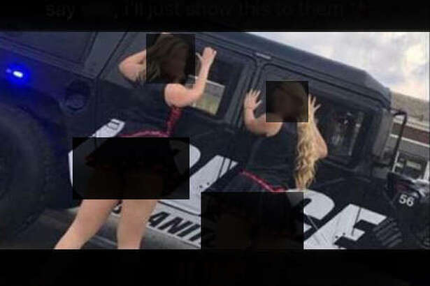 A screen capture of a Snapchat shared on social media Thursday depicts members of the Granite City High School Dance Team posing against a city police vehicle, with a team coach standing on the vehicle.