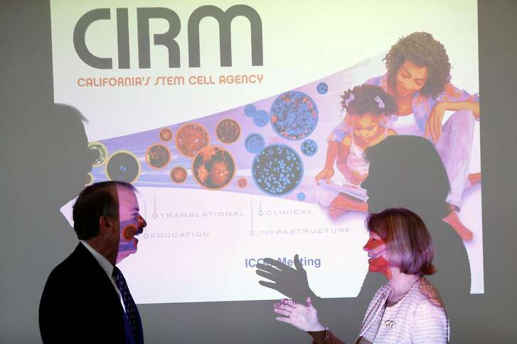 Chairman Jonathan Thomas (left) chats with board member Anne-Marie Duliege during the Regular Meeting of the Independent Citizens Oversight Committee and The Application Review Subcommittee  California Institute For Regenerative Medicine organized pursuant to the California Stem Cell Research and Cures Act in Oakland, Calif., on Thursday, December 14, 2017.