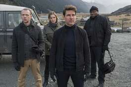"This image released by Paramount Pictures shows, from left, Simon Pegg, Rebecca Ferguson, Tom Cruise and Ving Rhames in a scene from ""Mission: Impossible - Fallout."" (David James/Paramount Pictures and Skydance via AP)"