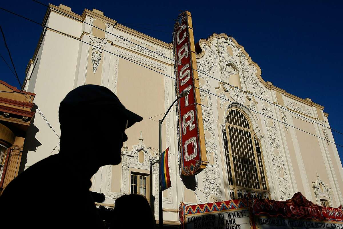 A man passes the Castro Theater during the Dyke March in San Francisco, Calif. on Saturday, June 28, 2014. The annual Dyke March featured live music and a parade through the Mission.