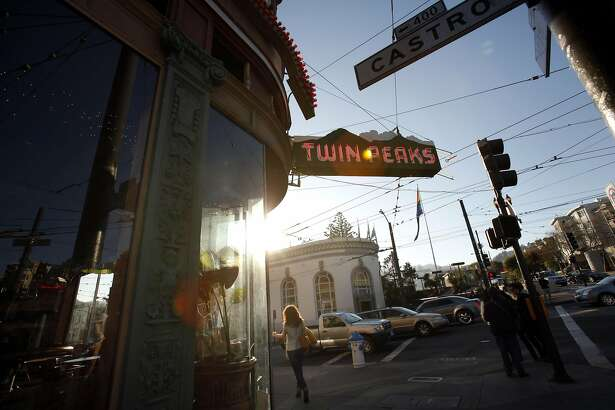 People walk by the Twin Peaks Tavern on Wednesday, January 16, 2013, in San Francisco, Calif. The SF Board of Supervisors recently granted historic landmark status to the Twin Peaks Tavern, an iconic Castro District bar. The bar is notable, in part, because it was the first gay gathering place to have clear glass windows.