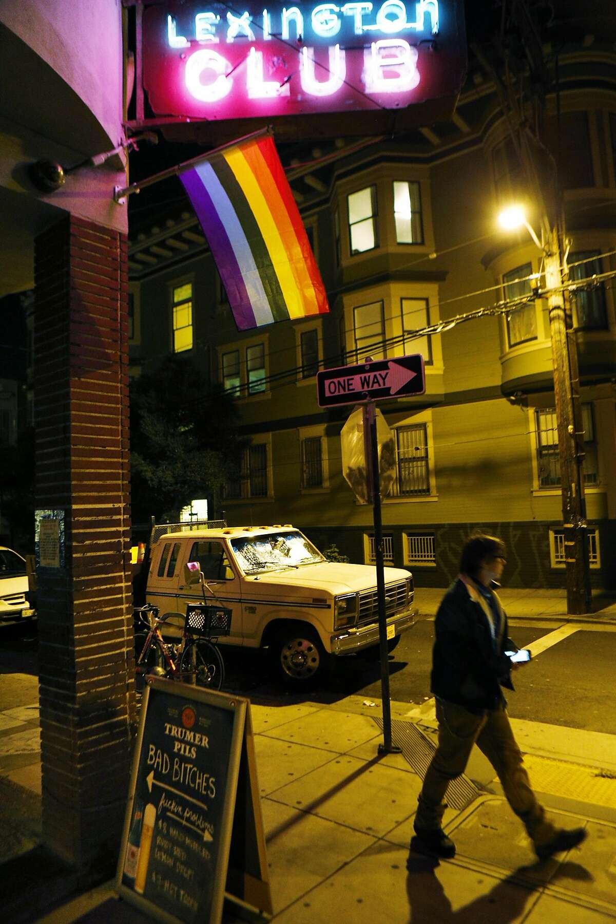 """Lynn Breedlove, owner of Homobiles, stops in at the Lexington Club to see if there's any need for his services in San Francisco, Calif., on Sunday, March 2, 2014. Homobiles is like Uber for drag queens. It's a network of volunteer drivers offering safe rides for """"gender and sexual outlaws"""" who otherwise risk harassment or violence. Drivers accept donations."""