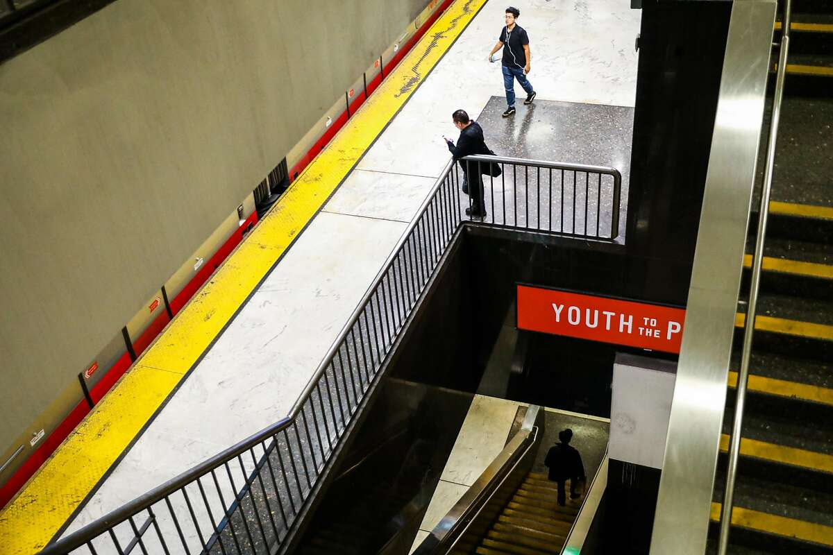 People wait for their strain at the BART station at Civic Center in San Francisco, California, on Thursday, Aug. 16, 2018.