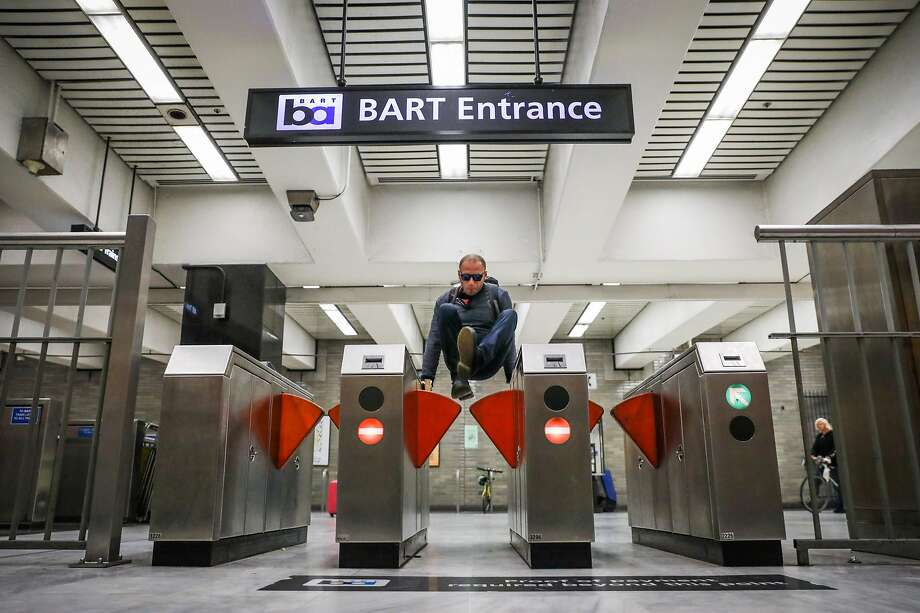 A man jumps the turnstile at the BART station at Civic Center despite gates that were installed to deter fare evasion in this Aug. 16, 2018, file photo. Photo: Gabrielle Lurie / The Chronicle 2018