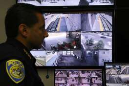 BART Police Chief Carlos Rojas stands in front of monitors displaying live images from multiple BART train stations, as he discusses the fatal stabbing of Nia Wilson, which occurred at the MacArthur BART station last Sunday, inside the video recovery room at BART Police Headquarters in Oakland, Cali. on Thursday, July 25, 2018.