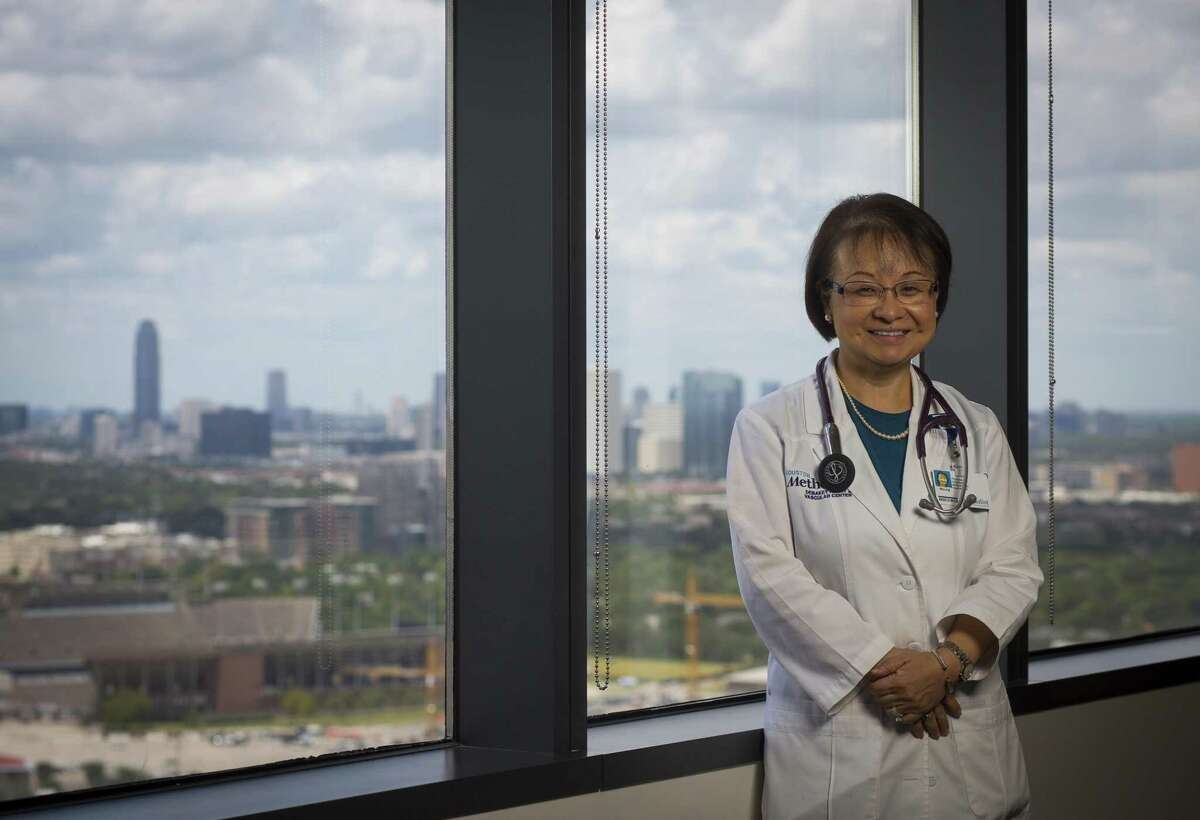 Dr. Myung Park crossed high waters tethered to her husband to get to Methodist Hospital to treat patients during flooding from Hurricane Harvey.