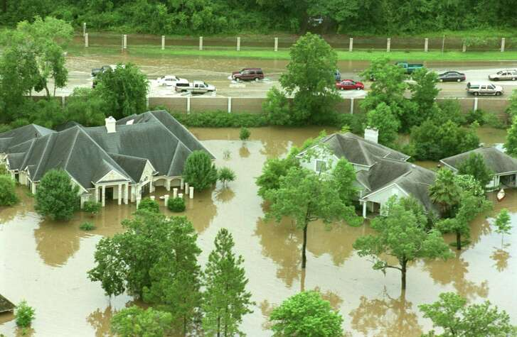 High water threatens houses at NASA Road 1 in Friendswood following flooding from Tropical Storm Allison in 2001. Flooding from storms including last year's Hurricane Harvey have Friendswood officials focused on how to protect their city. They are watching the Aug. 25 Harris County flood bond package, which proposes projects near the city. About 6,000 Friendswood residents live in Harris County.