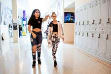 Sofia Valdez (left), 15, and Sophia Portolese, 15, walk the halls of the foreign language building at Alameda High School in Alameda, Calif. on Tuesday, August 14, 2018. Both girls are wearing clothing that would have previously not been allowed under the schools dress code policy. However with new changes to the policy, ripped jeans and midriff tops are just a few of the articles of clothing now allowed.