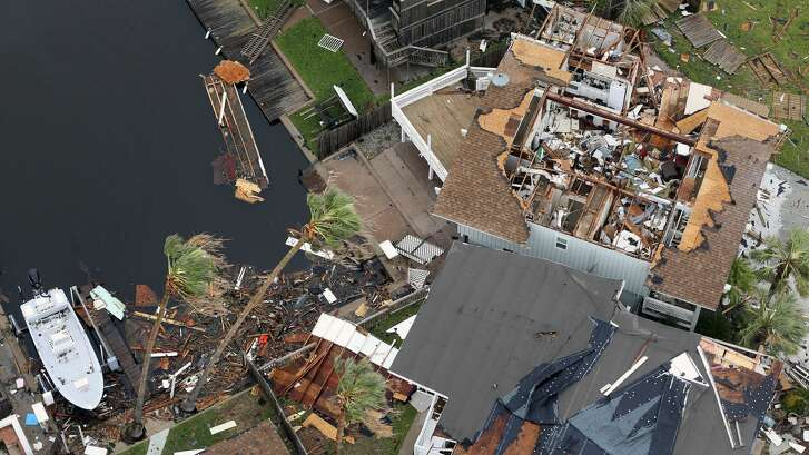 Storm-damaged Rockport, Texas homes are seen in this Sunday, Aug. 25, 2017 aerial photo.
