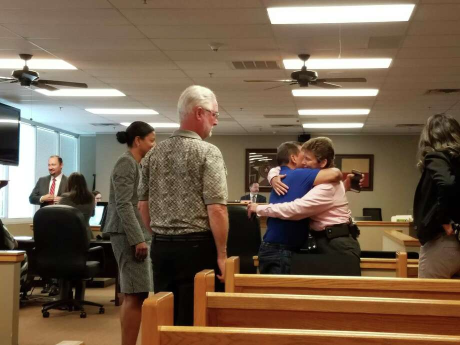 MCSO Detective Donna Rippley hugs German Enrique Huezo Reyes, the father of Oscar Salazar, who was shot and killed by Nelson Segovia-Amaya in December 2016. Judge Phil Grant sentenced Segovia-Amaya to life in prison on Friday. Photo: Jennifer Summer